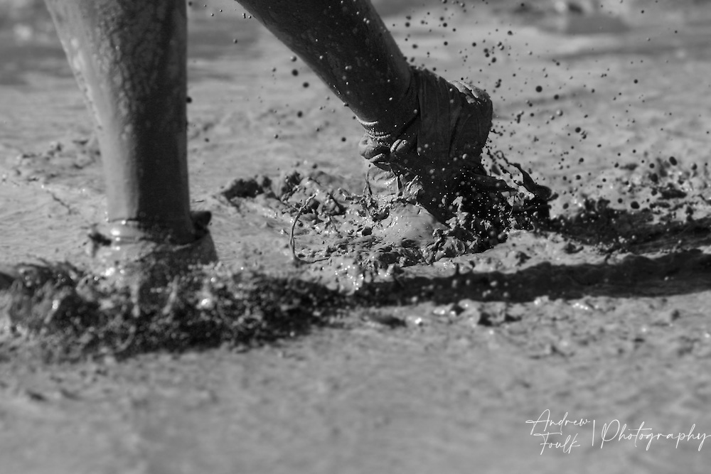 /Andrew Foulk/ For The Californian/ .A competitors feet race through the mud duing the Lake Elsinore Gladiator Run.