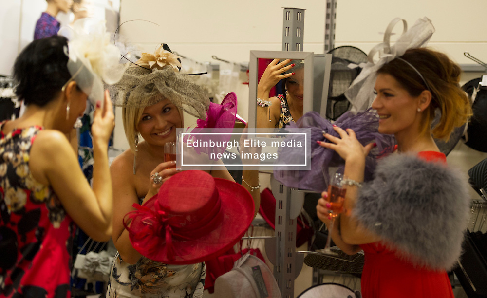 Eliza Swenarek, Dorota Drozdz and Kate Poddles try on hays after visiting Allure Medi Spa in Debenhams at Ocean Terminal to get ready for Ladies Day at Musselburgh Race Course. 11 June 2012 (Ger Harley   StockPix).