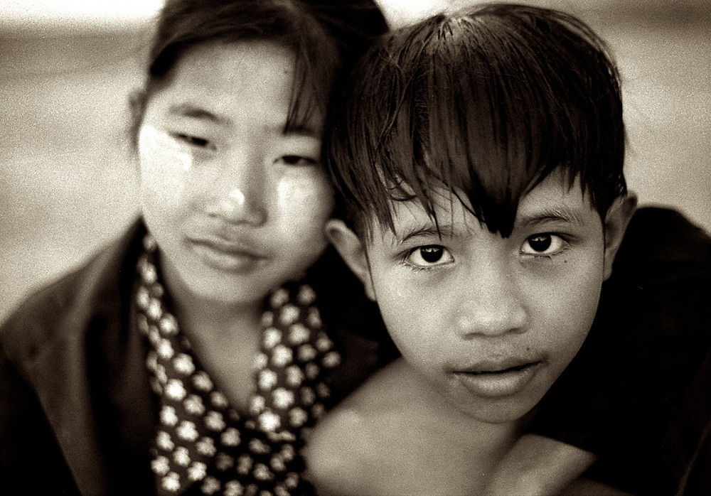 Brother and sister. Myanmar. <br /> Photo by Lorenz Berna