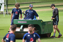 England's Ben Stokes moves the heavy roller during the nets session at Trent Bridge, Nottingham.