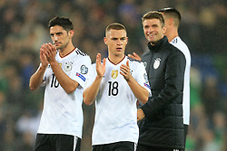 5th October 2017 - 2018 FIFA World Cup Qualifying (Group C) - Northern Ireland v Germany - Joshua Kimmich of Germany (C) and teammates Lars Stindl (L) and Thomas Muller (R) applaud the support - Photo: Simon Stacpoole / Offside.