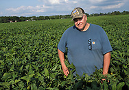 Grain farmer Paul Hlubik stands in a soy crop field on Sept. 19, 2018, before the upcoming harvest at Backacres Farms in Chesterfield, New Jersey. (Photo by Matt Smith)
