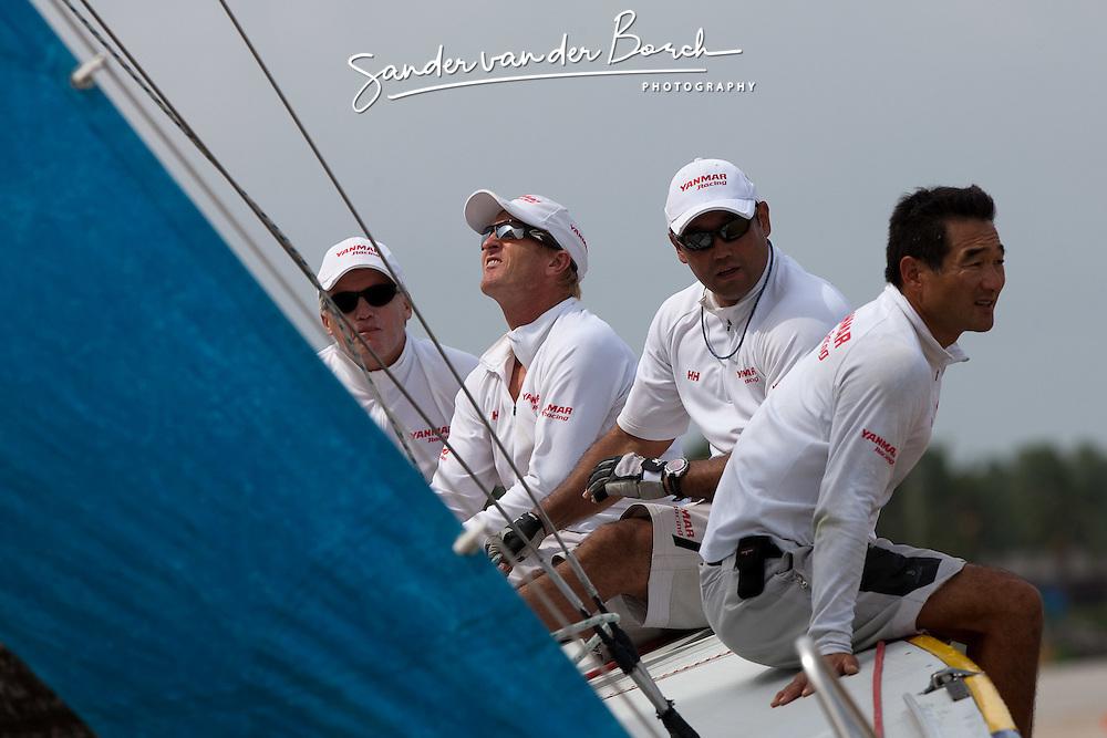 Peter Gilmour (AUS), Cameron Dunn, Yasuhiro Yaji and Kazuhiko Sofuku sailing upwind. Monsoon Cup 2009. Kuala Terengganu, Malaysia. 3 December 2009. Photo: Sander van der Borch / Subzero Images