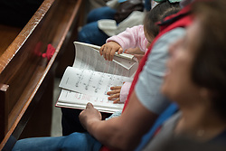 18 November 2018, Bogotá, Colombia: A young congregant reads the Bible during Sunday service at the Church of San Lucas. The church of San Lucas ('Saint Lucas') of the Evangelical Lutheran Church of Colombia, brings together a congregation of some 100 people in the southern areas of Bogotá. Located in the Kennedy area, the church has recently celebrated 50 years. As part of its ministry, the church runs a school and college, The Colegio Evangelico Luterano de Colombia (CELCO) San Lucas, offering education to just over 1,000 students aged 3-18. The school started as a social initiative offering care for children aged 0-4 in Bogotá's less wealthy neighbourhood, allowing the parents opportunities to go to work. 36 years after its foundation, the school employs 56 staff, of which 36 are teachers.