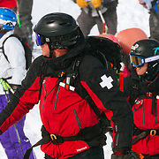 Jackson Hole Ski Patrol opens up the competition by setting the boundary line for participants.