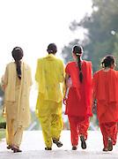 Women walk through Shalimar Bagh, a Mughal Garden. Mughal gardens were built by the Mughals in the Islamic style of architecture. Srinigar, Kashmir, India