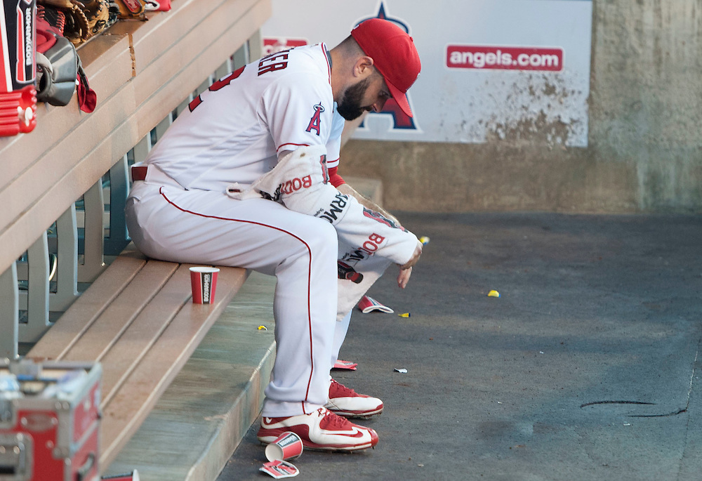 The Angels' Matt Shoemaker sits in the dugout between innings against the Oakland Athletics at Angel Stadium on Tuesday.<br /> <br /> ///ADDITIONAL INFO:   <br /> <br /> angels.0803.kjs  ---  Photo by KEVIN SULLIVAN / Orange County Register  -- 8/2/16<br /> <br /> The Los Angeles Angels take on the Oakland Athletics at Angel Stadium.
