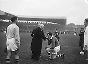 Cork captain kissing the hand of the Bishop before the beginning of the All Ireland Senior Gaelic Football Championship Final, Cork v Galway in Croke Park on the 7th October 1956. Galway 2-13 Cork 3-7.