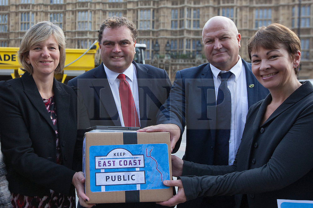 © Licensed to London News Pictures. 18/10/2013. London, UK. Lilian Greenwood (L), the Labour Shadow Rail Minister, Manuel Cortez (2L), general secretary of the Transport Salaried Staffs' Association (TSSA), Bob Crow (2R), General Secretary of the National Union of Rail, Maritime and Transport Workers, and Caroline Lucas (R), a recently arrested Green Party MP, are seen at a protest against the re-privatisation of the United Kingdom's East Coast Line in London today (18/10/2013) ahead of handing in a petition consisting of   23,000 commuter's signatures to the transport ministry. The East Coast Line, which runs from London to Scotland, is currently the only publicly owned train line after passing to the government from previous operator National Express who encountered financial difficulties. Photo credit: Matt Cetti-Roberts/LNP