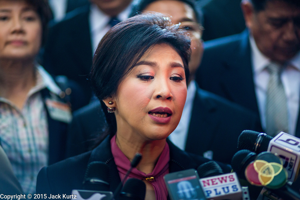 """09 JANUARY 2105 - BANGKOK, THAILAND: YINGLUCK SHINAWATRA, former Prime Minister of Thailand, talks to reporters after presenting her defense during her impeachment at the National Legislative Assembly. Thailand's military-appointed National Legislative Assembly began impeachment hearings Friday against former Prime Minister Yingluck Shinawatra. If she is convicted, she could be forced to stay out of politics for five years. During her defense, Yingluck questioned the necessity of her impeachment, saying, """"I was removed from office, the equivalent of being impeached, three times already, I have no position left to be impeached from."""" A decision on her impeachment is expected by the end of January.    PHOTO BY JACK KURTZ"""