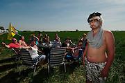 Boy in Sadam mask. Paris Roubaix classic, 2011