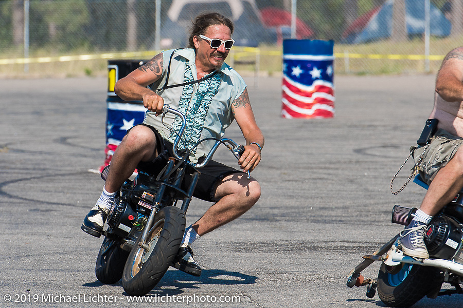 Bean're warms up on a minibike Friday afternoon during the Smokeout. Rockingham, NC. USA. June 19, 2015.  Photography ©2015 Michael Lichter.