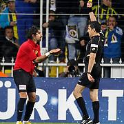 Referee's Bulent Yildirim (R) show the yellow card to Eskisehirspor's Erkan Zengin (L) during their Turkish superleague soccer match Fenerbahce between Eskisehirspor at Sukru Saracaoglu stadium in Istanbul Turkey on Sunday 14 April 2013. Photo by Aykut AKICI/TURKPIX