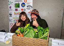 Pictured: Eve Massey (Onekind) and Simon Kenton-Lake (Nourish Sc otland) prfepare to feed the masses<br /><br />Food bank managers, unions, and farmers shared lunch while they met with MSPs on International Human Rights Day to discuss the upcoming Good Food Nation Bill<br /><br />Ger Harley | EEm 10 December 2019
