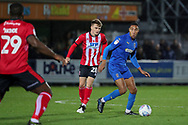AFC Wimbledon defender Terell Thomas (6) dribbling past Lincoln City midfielder Jake Hesketh (28) during the EFL Sky Bet League 1 match between AFC Wimbledon and Lincoln City at the Cherry Red Records Stadium, Kingston, England on 2 November 2019.