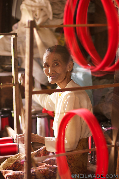 A woman spinns thread in a factory on Inle Lake, Myanmar.