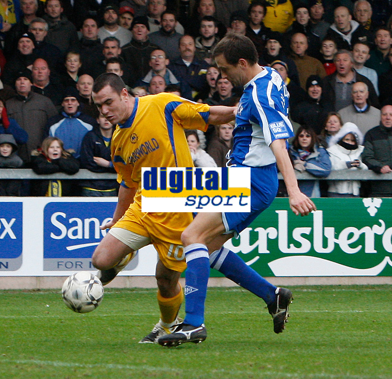 Photo: Steve Bond/Sportsbeat Images.<br />Torquay United v Exeter City. The FA Blue Square Premier. 01/01/2008. Lee Phillips (L) gets a shot in as Jon Richardson (R) closes in