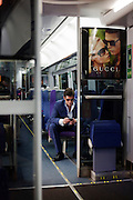 Heathrow Express passenger and sunglasses advertising seen en route between airport terminals.