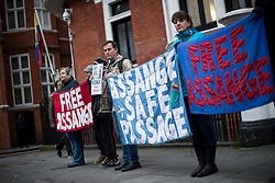 © Licensed to London News Pictures. 13/02/2018. London, UK. Supporters of WikiLeaks founder Julian Assange gather outside the Embassy of Ecuador in London following a court ruling on his arrest warrant. The Australian and Ecuadoran national skipped bail to enter the embassy in 2012 in order to avoid extradition to Sweden over allegations of sexual assault and rape, which he denies. Photo credit: Ben Cawthra/LNP