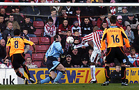 Photo. Glyn Thomas. <br /> Stoke City v Sheffield United. <br /> Coca Cola Championship. 12/03/2005.<br /> Stoke's Michael Duberry (second from R) clears off the line to prevent Sheffield from taking a 1-0 lead.