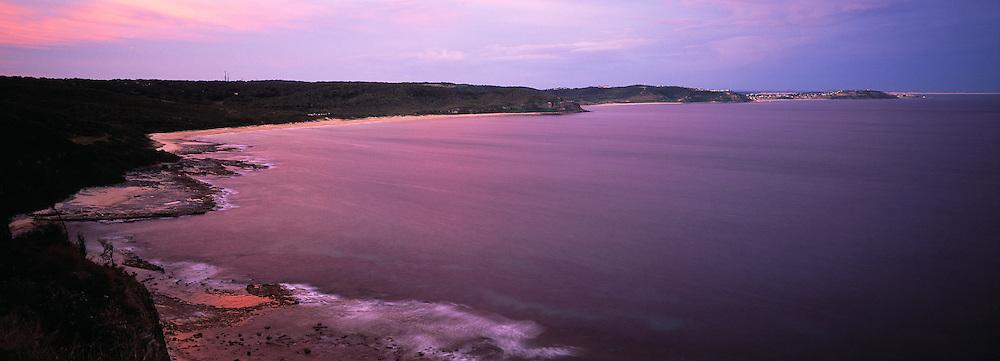 Sunset on coastline from Dudley Bluff towards Dudley Beach, Australia