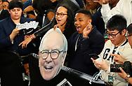 Students cheer the arrival of Berkshire Hathaway CEO Warren Buffett on the Berkshire Hathaway annual meeting weekend in Omaha, Nebraska, U.S. May 7, 2017. REUTERS/Rick Wilking