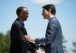 Prime Minister Justin Trudeau shakes hands with Rwanda's President Paul Kagame during a welcome for G7 outreach countries and international organizations at the G7 leaders summit in La Malbaie, Quebec on June 9, 2018. Photo by Justin Tang/CP/ABACAPRESS.COM