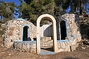 An old tomb now claimed to be a holy place and burial site of a miracle working holy man. Religious Jews seem to believe that visit such sites can cure illness, bring prosperity or find a romantic match for themselves or relatives. This kind of belief is totally against Jewish teachings