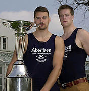 Putney. London.<br /> Hurlingham Club<br /> Photo Peter Spurrier<br /> 2002 Varsity Boat Race Weigh-in<br /> Americans Dan Perkins ( Left ) and Lucas McGee from the Oxford Blue Boat, with the Aberdeen Asset Management Trophy. [Mandatory Credit:Peter SPURRIER/Intersport Images] 20020325 University Boat Race,  Weigh In, Putney, London