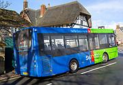 Green single decker service to Marlborough Swindon bus company bus at Avebury, Wiltshire, England, UK