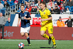 March 9, 2019 - Foxborough, MA, U.S. - FOXBOROUGH, MA - MARCH 09: Columbus Crew midfielder Wil Trapp (6) brings the ball upfield watched by ]New England Revolution midfielder Scott Caldwell (6) during a match between the New England Revolution and Columbus Crew SC on March 9, 2019, at Gillette Stadium in Foxborough, Massachusetts. (Photo by Fred Kfoury III/Icon Sportswire) (Credit Image: © Fred Kfoury Iii/Icon SMI via ZUMA Press)