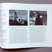 """""""Industrial Cathedrals of the North"""" catalogue published in 1999 of Louie Palu's images of mine sites and their architecture including written essays by Charlie Angus. (Credit Image: © Louie Palu/ZUMA Press)"""