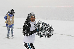 A Philadelphia Eagles Cheerleader cheers on the sideline in the snow during the NFL game between the Detroit Lions and the Philadelphia Eagles on Sunday, December 8th 2013 in Philadelphia. (Photo by Brian Garfinkel)