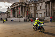 Police Patrolling a deserted Trafalgar Square as the Coronovirus clampdown began on Friday evening rush hour on 20th March 2020 in London, United Kingdom. All bars and resturants were being closed at this time throughout the UK.