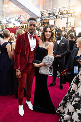 Stephan James and guest arrive on the red carpet of The 91st Oscars® at the Dolby® Theatre in Hollywood, CA on Sunday, February 24, 2019.