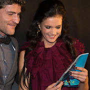 NLD/Amsterdam/20131204 - Presentatie Kerst Playboy met Marly van der Velden, Koert Jan de Bruijn overhandigd het eerste exemplaar aan  Marly van der Velden