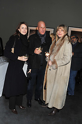 Left to right, DOROTHEA ADAMSON, VEDAT YELKENCI and PAOLA THOLSTRUP at a private view of photographs by Christopher Thomas entit;ed 'Venice in Solitude' held at Hamiltons, 13 Carlos Place, London on 31st January 2012.