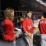 NEW YORK, NEW YORK - July 09: Jayson Werth #28 of the Washington Nationals and Bryce Harper #34 of the Washington Nationals in the dugout preparing to bat during the Washington Nationals Vs New York Mets regular season MLB game at Citi Field on July 09, 2016 in New York City. (Photo by Tim Clayton/Corbis via Getty Images)