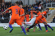 Eric Garc?a Martret of Spain (4) goes down in the box during the UEFA European Under 17 Championship 2018 match between Netherlands and Spain at the Pirelli Stadium, Burton upon Trent, England on 8 May 2018. Picture by Mick Haynes.