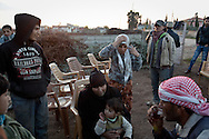 Um Amr, centre, sits with some of her relatives in the garden of their home in Davutpasa. The Jasem family share the three bedroom home with more than 60 members of their extended family. Davutpasa, Turkey. 12/29/2012. Bradley Secker for the Washington Post