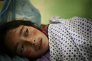 Qamar, a 26-year-old tuberculosis patient from Shohada district, lies in her bed at Faizabad Provincial Hospital, Faizabad in Badakshan province, Afghanistan, Sunday, May 13, 2007.