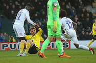 Burton Albion midfielder David Templeton (11) is helped up by Coventry City forward Jordy Hiwula (11) during the EFL Sky Bet League 1 match between Burton Albion and Coventry City at the Pirelli Stadium, Burton upon Trent, England on 17 November 2018.