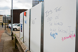 """Sheffield UK Friday 3 April 2020 <br /> """"Its The End Of The World As We Know It"""" Graffiti on a hoarding Caver Street Sheffield scrawled during the Coronavirus Crisis <br /> <br /> 3 April 2020<br /> <br /> www.pauldaviddrabble.co.uk<br /> All Images Copyright Paul David Drabble - <br /> All rights Reserved - <br /> Moral Rights Asserted -"""