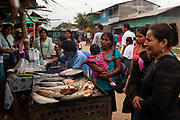 Selling fried fish in Boca Colorado, Peru. Boca Colorado is a town formed entirely by mining activity in the Peruvian Amazon.