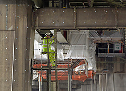 © Licensed to London News Pictures. 09/07/2012. London, UK Construction workers and scaffolding underneath the M4 motorway at The Boston Manor Viaduct today 9th July 2012. The M4 has been closed between junctions 1 and 3 after a crack was found in a 'sensitive area' of an elevated section of the motorway. The M4, part of the Olympic Route Network, will be vital for transporting visitors into the city from Heathrow Airport. Photo credit : Stephen Simpson/LNP