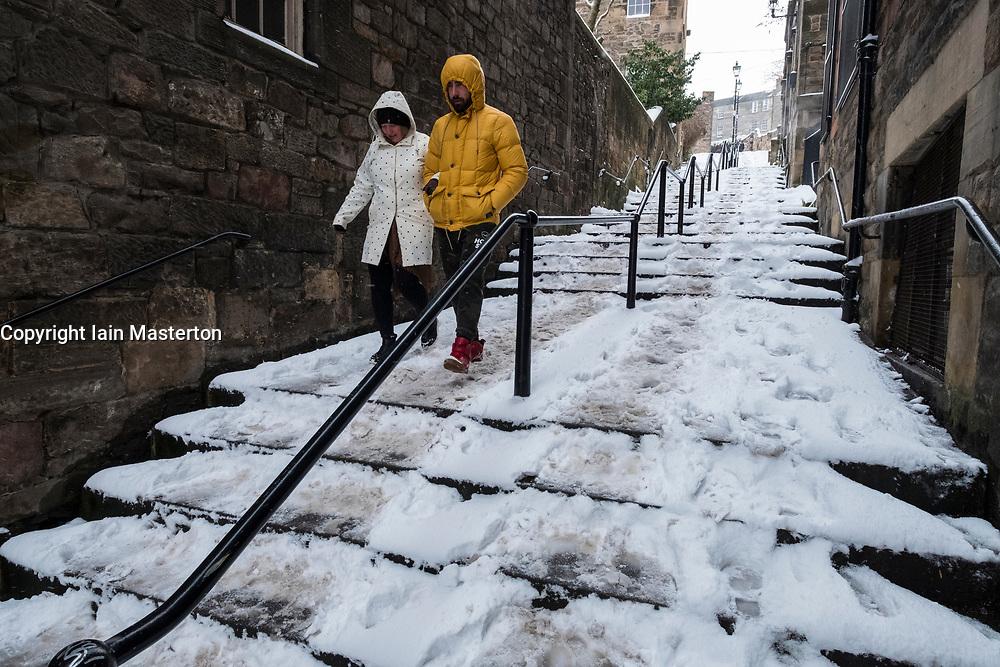 the historic Vennel steps at Grassmarket under snow in Edinburgh Old Town, Scotland, United Kingdom