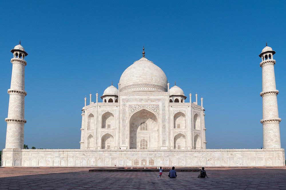 A couple peacefully admiring the Taj.