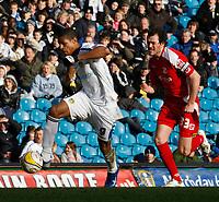 Photo: Steve Bond/Richard Lane Photography. Leeds United v Swindon Town. Coca Cola League One. 14/03/2009. Jermaine Beckford (L) heads for goal pursued by Gordon Greer