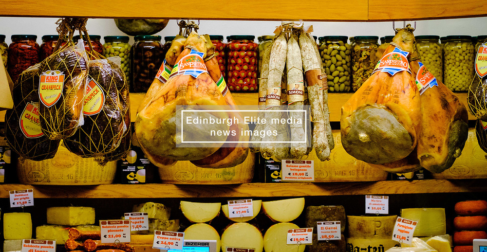 Hams and cheeses in a shop in Bologna Italy<br /> <br /> (c) Andrew Wilson   Edinburgh Elite media