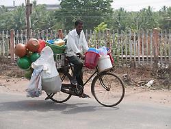 Plastic kitchenware vendor on bicycle, Mysore